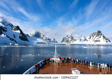 A cruise ship along the coasts of the Antarctic Peninsula, Antarctica. Lemaire Channel, Antarctic Peninsula, Antarctica - December, 2016