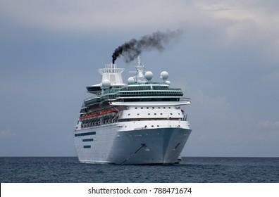Cruise ship anchored near an island in the Bahamas.