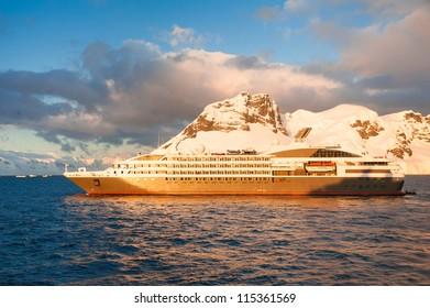 Cruise ship in Antarctica, beautiful sunset