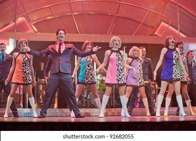 Cruise Ship, Caribbean Sea - DEC 4: Cabaret performers in stage show on cruise ship off Cayman Islands on December 4, 2011. Cruising now accounts for $30 billion, with 20 million passengers worldwide.