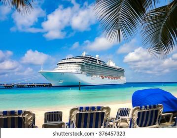 Cruise Ship close at the beach on a tropical Island.