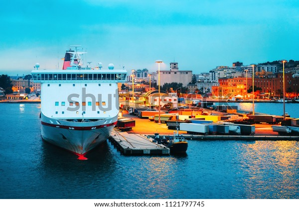 Cruise ship and containers in the Mediterranean Sea at the port in Cagliari, Sardinia island, Italy
