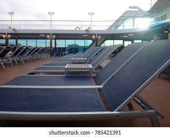 Cruise ship deck chairs ready for passengers to relax.