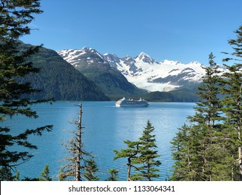 Cruise Ship departing Whittier, Alaska with snowy mountains in the background