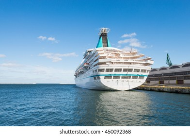cruise ship docked in harbor