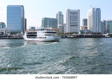 a cruise ship is docked at odaiba marine park