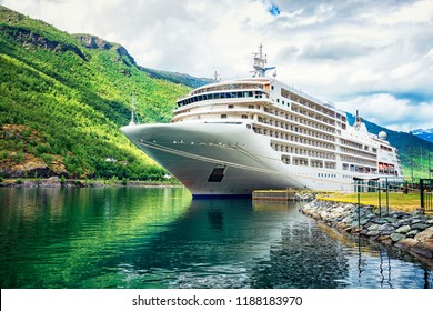 The cruise ship docked on a marina in the fjords