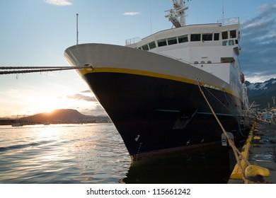 Cruise ship docked in Ushuaia at sunset
