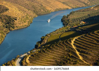 Cruise ship in Douro river and Alto Douro vineyards and landscape - UNESCO World Heritage
