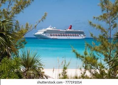 The cruise ship drifting near uninhabited island Half Moon Cay, popular tourist destination in The Bahamas.