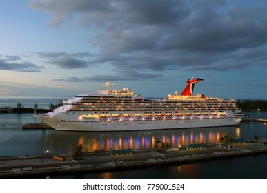 Cruise ship at dusk docked in port of Nassau, Bahamas.