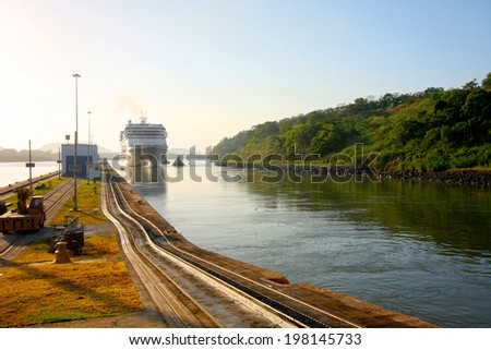 Cruise ship enters the Miraflores lock in the Panama Canal. Early morning on a beautiful sunny day in Panama.