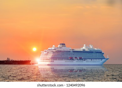 Cruise ship, Ferry sailing in Logistics import export background of container Cargo ship in seaport  the bright sunset background