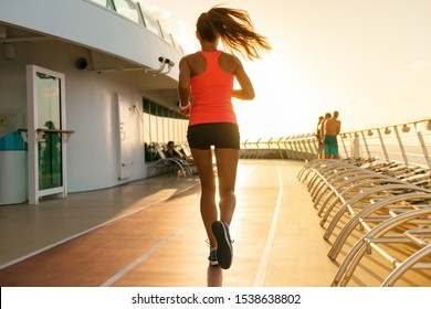 Cruise ship fitness exercise woman run jogging on running tracks on deck of boat. Caribbean travel vacation lifestyle.