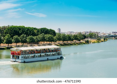 Cruise Ship Floating In Guadalquivir River In Seville, Spain.