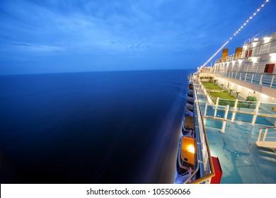 cruise ship floats at night, long exposure