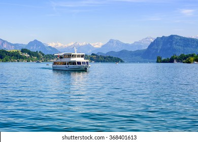 Cruise ship in front of snow covered Alps mountains peaks on Lake Lucerne, central Switzerland