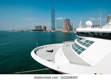 Cruise Ship and HongKong skyscraper skyline  at the Hong Kong cruise terminal, Kowloon