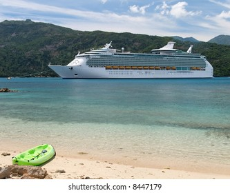 Cruise ship with a kayak in the foreground