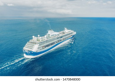 Cruise ship liner sails in the blue sea leaving a plume on the surface of the water seascape. Aerial view The concept of sea travel, cruises