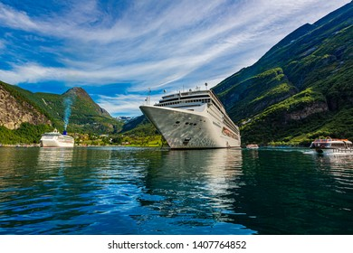 Cruise Ship, Cruise Liners On Geiranger fjord, Norway. The fjord is one of Norway's most visited tourist sites. Geiranger Fjord, a UNESCO World Heritage Site