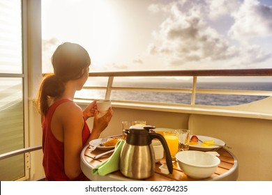Cruise ship luxury travel woman eating breakfast from room service on suite balcony enjoying morning view of Caribbean ocean. Summer sailing vacation lifestyle people drinking coffee.