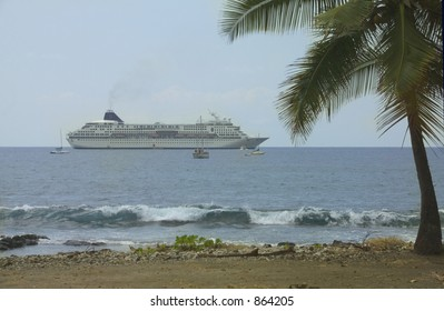 Cruise ship moored with palm trees