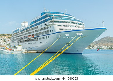 Cruise ship moored with yellow ropes at Patmos in the Greek Islands