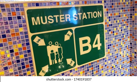 Cruise ship Muster station emergency sign for guest and crue togeather Muster station B4 sign on a wall - Shutterstock ID 1740191837