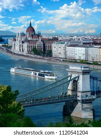 Cruise ship on the Danube River with a view of the Hungarian Parliament Building - Budapest, Hungary
