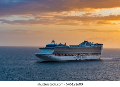 Cruise Ship on the Ocean at Sunset