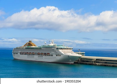 Cruise ship on sea in Funchal port, Madeira island, Portugal