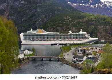 Cruise ship on very calm lake near Olden, Norway Fjords