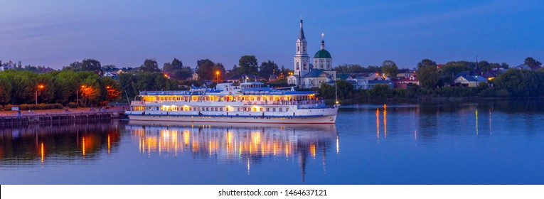 Cruise ship on Volga river against St. Catherine's monastery in summer evening. Beautiful night Russian panoramic cityscape with cruise liner on water. Travel blog concept, banner. Tver, Russia