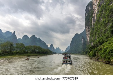 Cruise ship packed with tourists travels the magnificent scenic route along the Li river from Guilin to Yangshou.