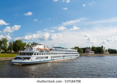 Cruise ship passenger stands on the banks of the Volga River city of Uglich in Russia