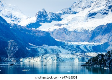 Cruise ship passengers get a close-up view of the majestic glaciers as they sail in Glacier Bay National Park and Preserve in Southeast Alaska, one of the world's largest protected natural areas.