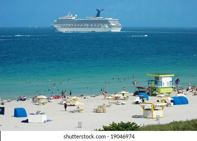 Cruise ship passing by a beach resort in South Beach, Miami, Florida