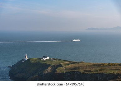 Cruise ship passing by light house close to Howath Summit, Dublin, Ireland