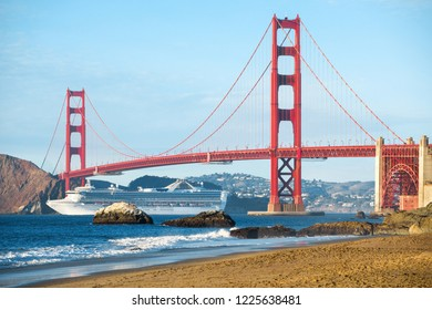 Cruise ship passing Golden Gate Bridge with the skyline of San Francisco in the background, California, USA