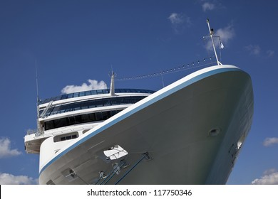 Cruise ship in port against blue sky