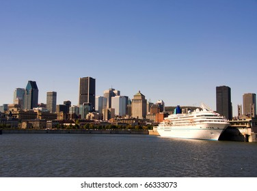 Cruise ship in the port of Montreal with a part of Downtown in the background