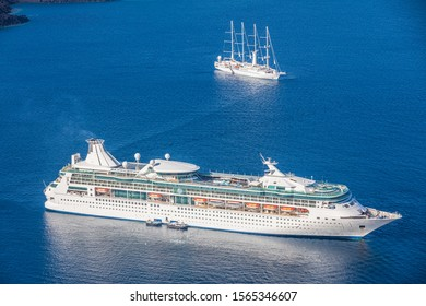 Cruise ship and sailboat in blue ocean. Summer travel and cruise vacation, passengers travelling with small ferry