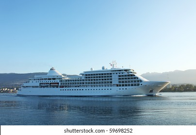 Cruise ship sailing into port in the early morning light