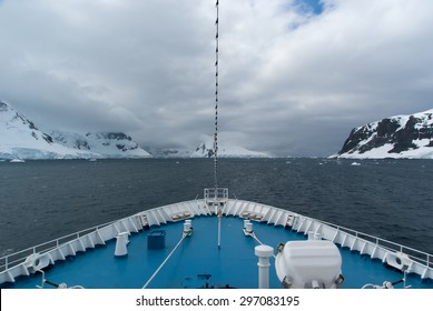 Cruise ship sailing through beautifull Lemaire Channel in Antarctica