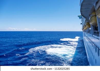 Cruise ship sailing towards the horizon on a perfect day