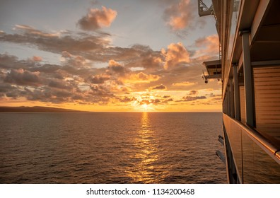 Cruise ship sailing towards a magnificent sunset