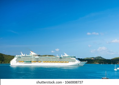 cruise ship at seaside. Ocean liner in blue sea on sunny sky. Water transport and vessel. Travel by sea, wanderlust. Summer vacation on island.