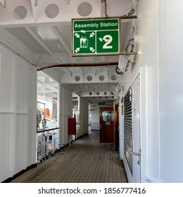 A cruise ship sign designating where the assembly station is in case of emergency. - Shutterstock ID 1856777416