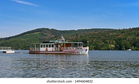 Cruise ship / steamer on the Brno dam. Beautiful summer sunny during recreation - vacation near water